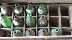 Old beer empty bottles in an wooden crate Stock Footage