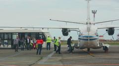 Passengers board a plane Stock Footage