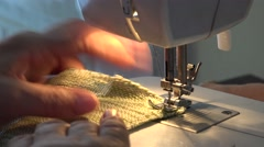 Detail of woman hand working at sewing machine, industry Stock Footage