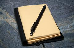 open journal with mechanical pencil - stock photo