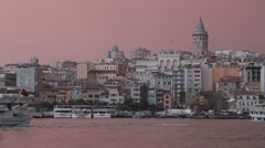 Stock Video Footage of A ferry at Golden Horn with Galata Tower in the background
