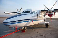 New white Let 410 airplane parked at the airport Baikal Stock Photos