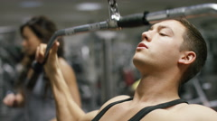 Handsome man working out in the gym doing lateral pulldowns Stock Footage