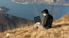 Finish work on the computer and enjoy the scenery Stock Footage