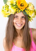 portrait of beautiful girl with floral wreath on her head - stock photo