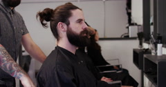 Professional barbering his client at the barbershop. Stock Footage