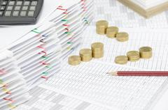 Brown pencil on finance account have calculator on pile document Stock Photos