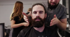 Barber putting the finishing touch on a clients beard. Shot on RED Epic. Stock Footage