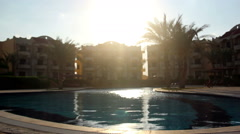 Swimming pool without people in the hotel at sunset Stock Footage