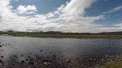 Stock Video Footage of Low Mongolian sky over Unhurried Flow Mongolian Crystal Clear River in The