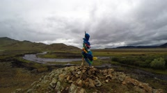 Multiply Multicolored Bandages on The Pole Near Rocky Shore of a Mountain River - stock footage