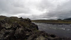 Stock Video Footage of Rocky Shore of a Mountain River in The Vast Mongolian Steppe