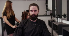 Portrait of an attractive hipster man in a salon. Shot on RED Epic. Stock Footage