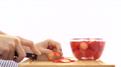 Slicing red strawberries into thin pieces Stock Footage