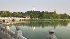 Wide view of the bridge, lake and white dagoba, beihai park Stock Footage