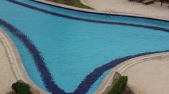 Bird walks near a swimming pool, heron Stock Footage