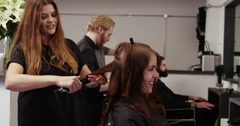 An attractive young woman getting hair styled in salon. Shot on RED Epic. Stock Footage