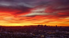 Beautiful fiery red sunrise city Los Angeles skyline cityscape. 4K UHD timelapse Stock Footage