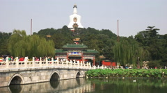 Medium view of the white dagoba in china's beihai park Stock Footage