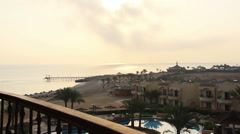 View from the balcony of the hotel on the beach at sunset Stock Footage