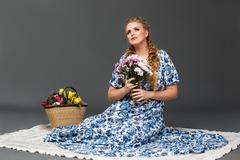 Young beautiful woman posing in studio Stock Photos
