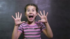 girl teen experiencing of surprising happiness joy on gray background - stock footage