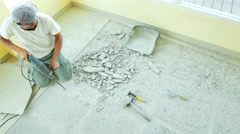 Repairing the cement floor tile Stock Footage