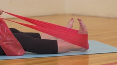 Womans foot streching using exercise band Stock Footage