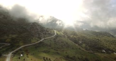 4K Aerial, Flight over andalusian village, surrounded by massive mountains, Spai Stock Footage