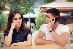 Angry Girl Listening to Her Boyfriend Talking on The Phone  Stock Photos