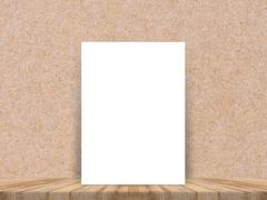 Blank white paper poster at tropical plank wooden floor and paper wall. - stock photo