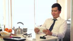 Japanese Businessman Business Man Using Ipad Digital Tablet During Breakfast. Stock Footage