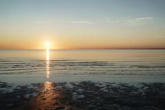 Sunset above sea shot from beach Stock Photos
