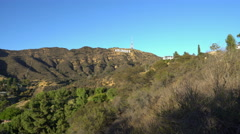 Stock Video Footage of Tracking Shot of Hollywood Sign in Daytime -Dolly Down/Left-