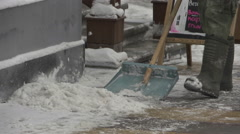 Snow clearance 9. Janitor with a snow shovel. - stock footage