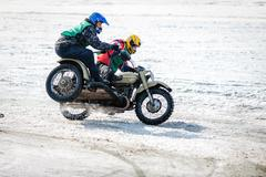 Ulan-Ude, RUSSIA - January, 2014: Competitors at winter bike competition on ice. - stock photo