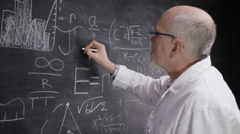 4K Portrait of academic man writing math formulas on blackboard - stock footage