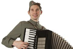 Portrait of Soviet soldier with accordion over white - stock photo