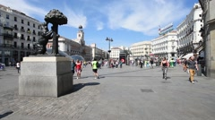 People are walking on the Puerta del Sol in Madrid Stock Footage