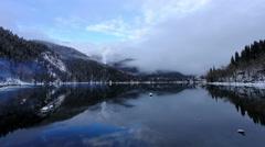 4K. Alpine Lake Ritsa in winter under gloomy clouds, Abkhazia, Ultra HD. Stock Footage