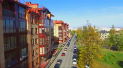 Aerial view of the five storey building of red brick and glazed balconies Stock Footage