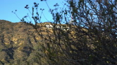Stock Video Footage of Tracking Shot of Hollywood Sign in Daytime -Dolly Pull-