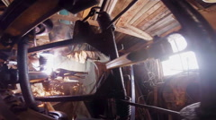 Man Welding a Snowmobile Frame in a Workshop Stock Footage