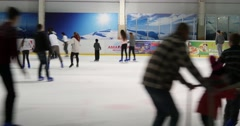 Indoor Ice Skating Park Wiith Skating People 4k Stock Footage