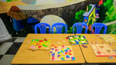 Children's Books Disappear off Table in Kindergarten - stock footage