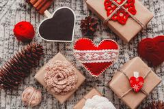 Valentine's Day symbols - hearts, presents in craft paper with crochet flower - stock photo
