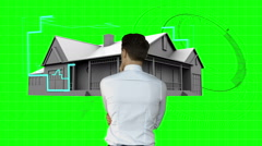Stock Video Footage of Architect designing house on green interface