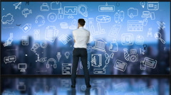Businessman looking at tech interface Stock Footage