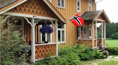 Norwegian house with the Norwegian National flag in Straumen, Norway. Stock Footage
