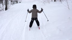 Little boy cross country skiing in the new snow Stock Footage